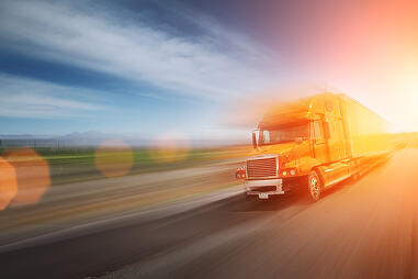 bigstock-Truck-On-Freeway-12557069
